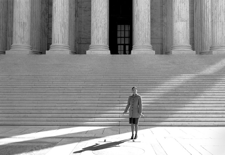 Justice Ruth Bader Ginsburg '54 stands outside the Supreme Court building in Washington on her first day on the job, Oct. 1, 1993. Ginsburg was the second woman to serve on the Supreme Court and a pioneering advocate for women's rights.