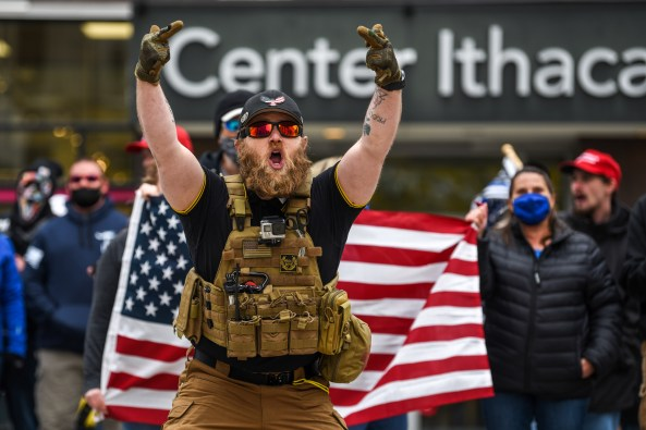 """A Back the Blue protester donned a bulletproof vest with a """"Proud Boys"""" logo patch on the front."""