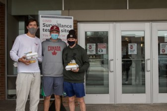 """The handling of the COVID-19 pandemic was on the minds of Walker Wallace '24 (left) and Ryan Sheehan '24 (right) as they cast their votes for Donald Trump. """"I'm from Canada,"""" Rory Graham '24 said."""