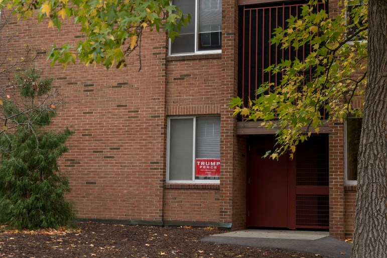 In contrast to Donlon's post-its, residents displayed a Trump Pence sign in the window of a low rise dorm.