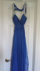 $40 + shipping. Royal blue gown with small tear in train. AB stones. Size 4. Can be easily turned into a cocktail dress. Worn once for appearance.