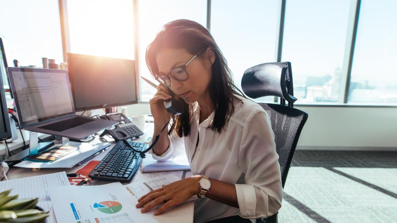 woman auditing company benefits policies for compliance