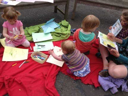 Toddlers drawing and reading. Photo by Itay Idan