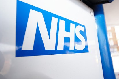 Unique ID: FRAM519 Caption: The NHS logo on hospital signage. Patient information. NHS identity. Branding. Restrictions: NHS Photo Library - for use in NHS, local authority Social Care services and Department of Health material only Copyright: ©Crown Copyright