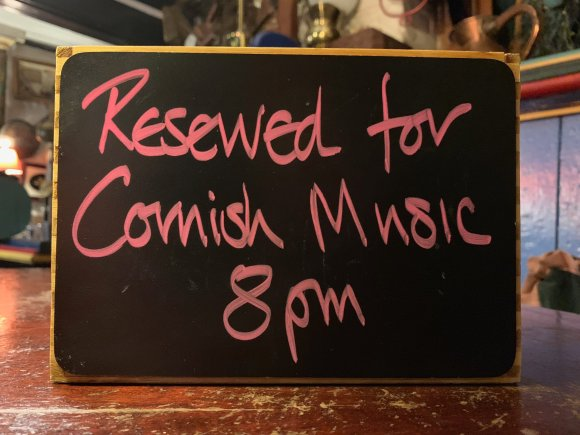 "Small blackboard sign reading ""Reserved for Cornish Music 8pm"""