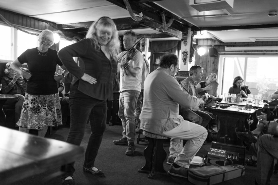 Black and white photograph by Lee J Palmer of musicians playing at the Admiral Benbow pub for Cornish dancers.