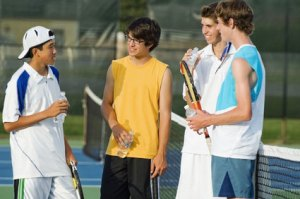 Young Men Talking Tennis