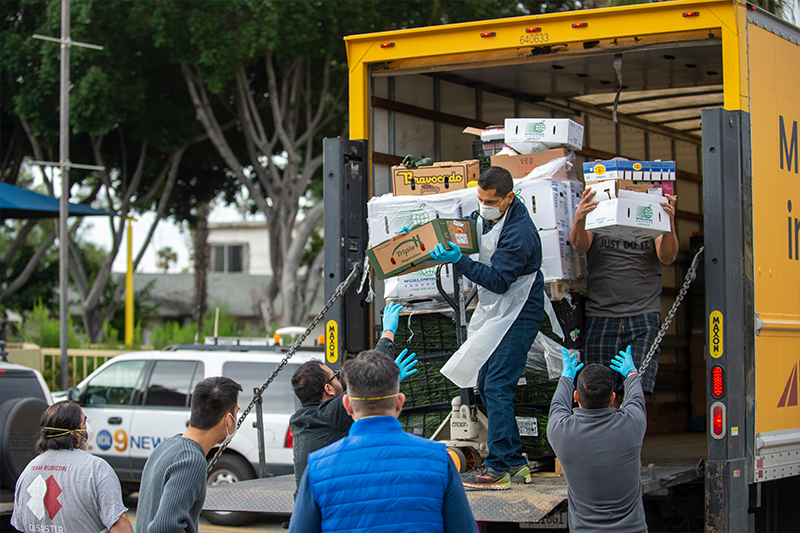 USC community volunteers unloading a truck to provide food and other necessities