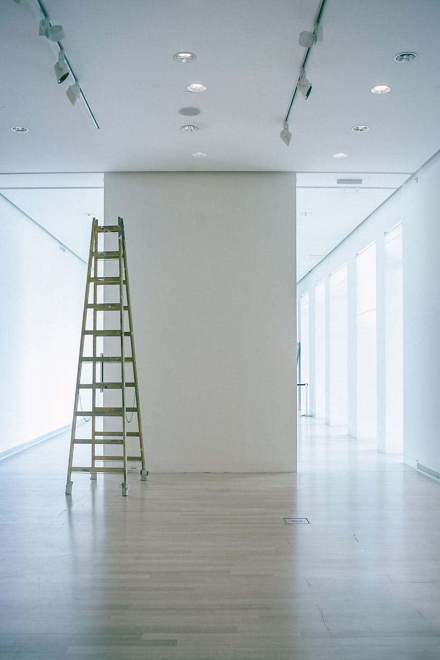 empty corridor with ladder and lamps on ceiling