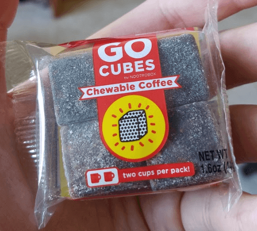 holding my new pack of go cubes from nootrobox