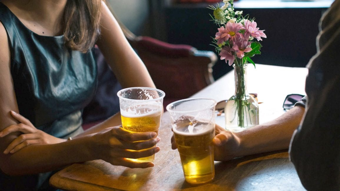 two people on a date drinking beer