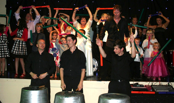 Drummers onstage with a wedding party playing boomwhackers - weddings and private events