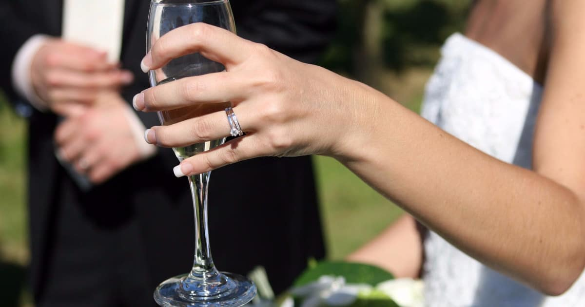 how to deal when your boss makes rude comments about your engagement ring - image of a bride's ring finger