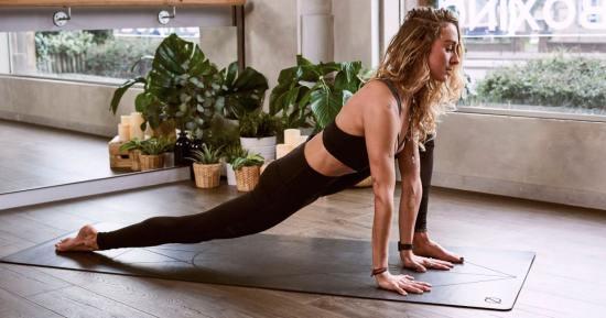 stock photo of young woman doing yoga pose
