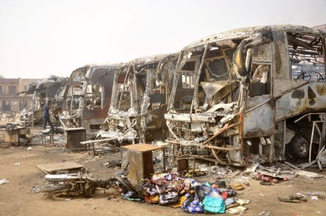 Remains of buses after Monday's explosions at a bus park in Sabon Gari in Kano March 19, 2013.