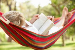 person reading in hammock