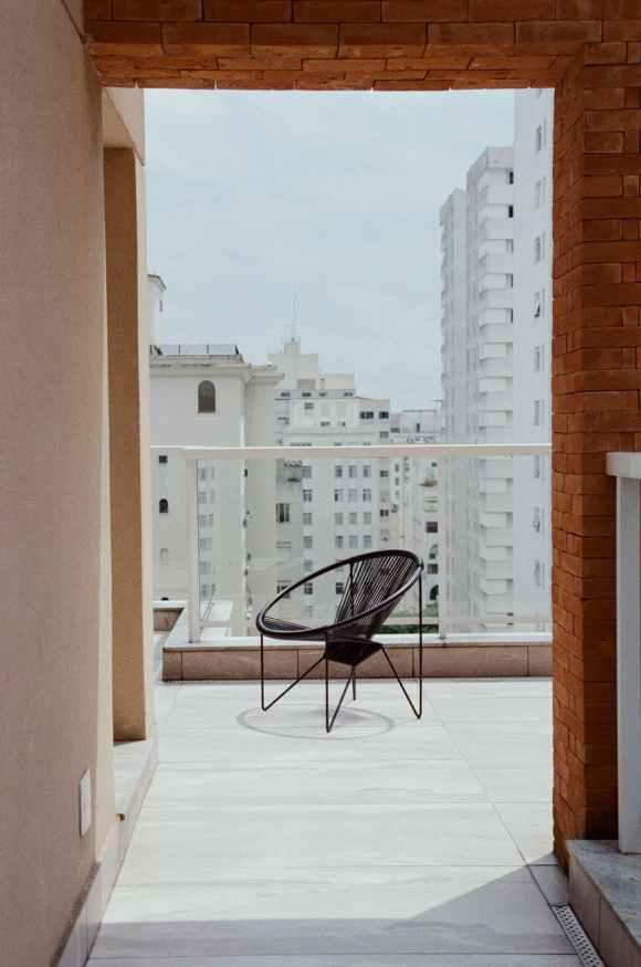 modern chair on balcony of modern building