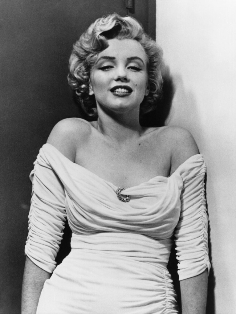 USA. Hollywood, California. 1952. US actress Marilyn MONROE posing for a cover photograph for LIFE Magazine. 1952. LIFE magazine assigned photographer Philippe HALSMAN to go to Hollywood to photograph Marilyn Monroe in the small studio appartment that she had in Hollywood. The resulting cover photo gave her the status of a STAR and her studio 20th Century Fox then readjusted her contract.