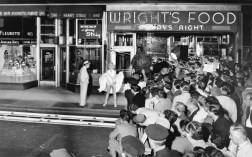 "NEW YORK - SEPTEMBER 1954: Marilyn Monroe stands over a subway grate with her white dress blowing with co-star Tom Ewell and a crowd of onlookers at the corner of 51st Street and Lexington Avenue during the filming of ""The Seven Year Itch"" in September, 1954 in New York, New York. (Photo by Sam Shaw/Shaw Family Archives/Getty Images)"