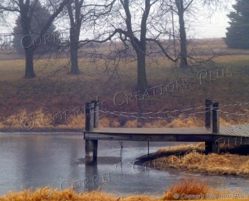 Pier jutting into small pond on a foggy afternoon in southeastern Nebraska