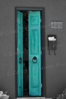 I used one-point color to emphasize the teal-colored door of a home in downtown Tucson.