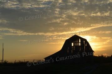 The sun sets behind an old barn in southeastern Nebraska.