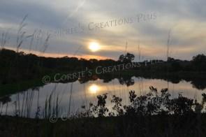 The setting sun reflects off a lake in southeastern Nebraska.