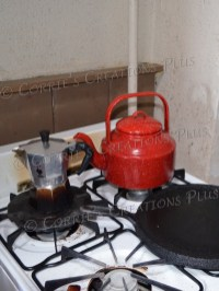 I love the red teakettle in this retro kitchen.