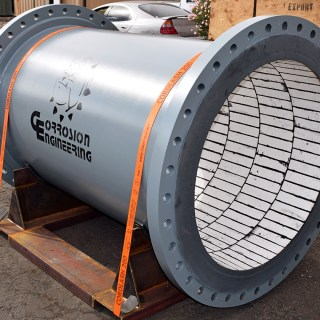 Large diameter ceramic-lined spool from Corrosion Engineering. Lined with premium, proprietary abrasion-resistant ceramics and bonded with high-tensile rubber.