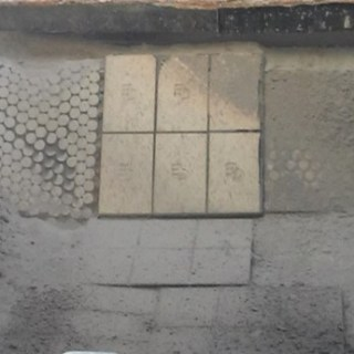 This image shows the liner installed in the area where the material is received (the impact zone). Aside from not showing any cracks, the Corrosion Engineering logo is still observed on each tile, which shows how little wear they have suffered.