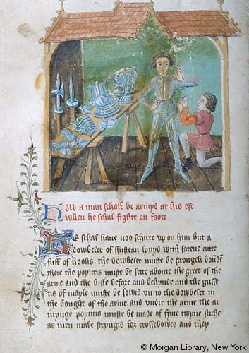 An illumination of a man standing next to a trestle table while a kneeling servant helps him put on his armour