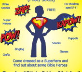 Silhouetted superhero in cape with J on chest