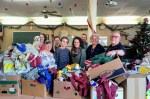 Oasis team, preparing Christmas gift bags for refugees