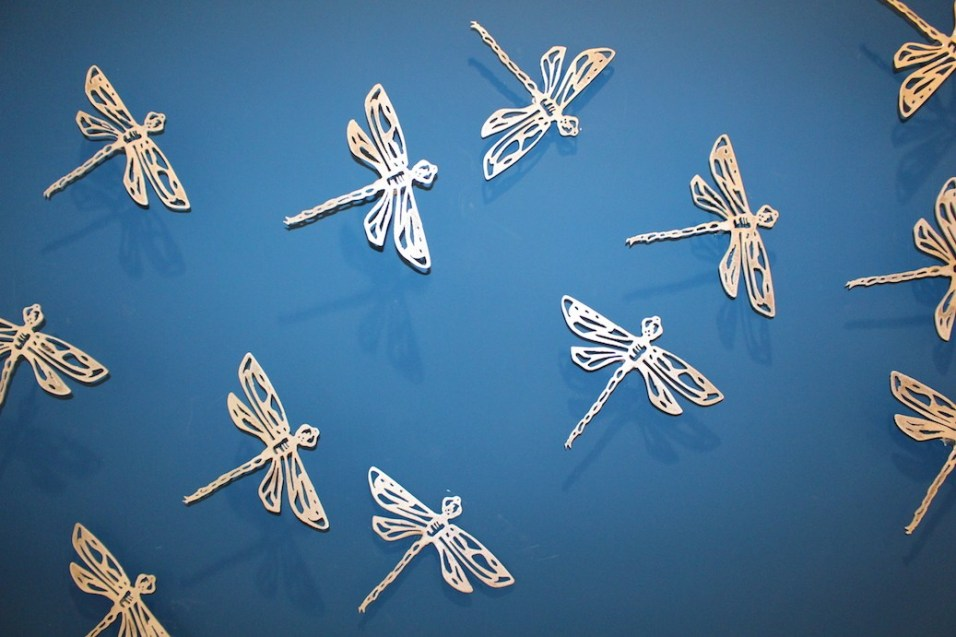 """Xavier Cortada, """"Dragonflies on Blue (detail),"""" brushed aluminum cut-outs, 2014."""