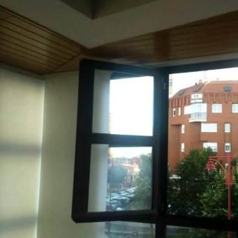 Apertura ventanas con paneles deslizantes en esquina para mirador