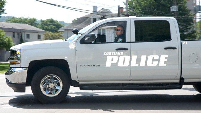 City Police Officer Kyle Green patrols downtown Cortland on Friday in a white Chevrolet Silverado with ghosted lettering that is made visible using a camera flash. City police purchased two ghosted vehicles this year, a 2016 Chevrolet Tahoe and a 2016 Chevrolet Silverado. The vehicles will help police crack down on violations for speeding and seat belt usage, said Deputy Chief Paul Sandy.