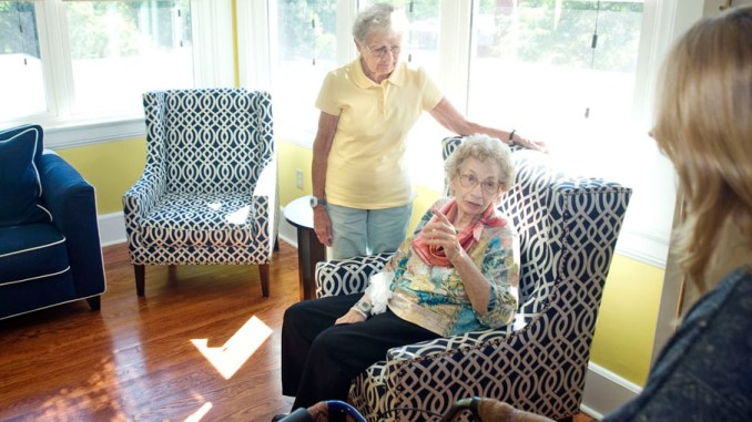 Brewster House residents Lucille Ripley, left, and Sally O'Shea, sit in newly remodeled second-floor sun room Wednesday on the second floor of the Brewster House in Homer.