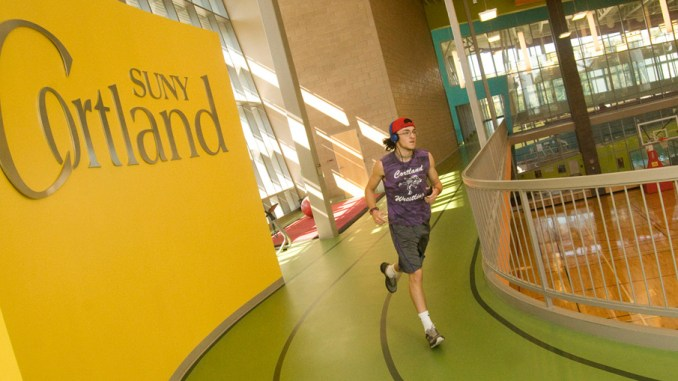 Jacob Smith, a SUNY Cortland freshman and Cortland High School graduate, runs Wednesday on the track on the upper portion of the Student Life Center.