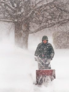 Bob Ellis/staff photographer John Bardsley was up early in the midst of the season's first storm Monday morning clearing his William Street sidewalk.
