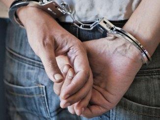 Handcuffed person stock image