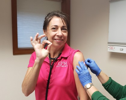 Dr. Gamelin gets a flu shot