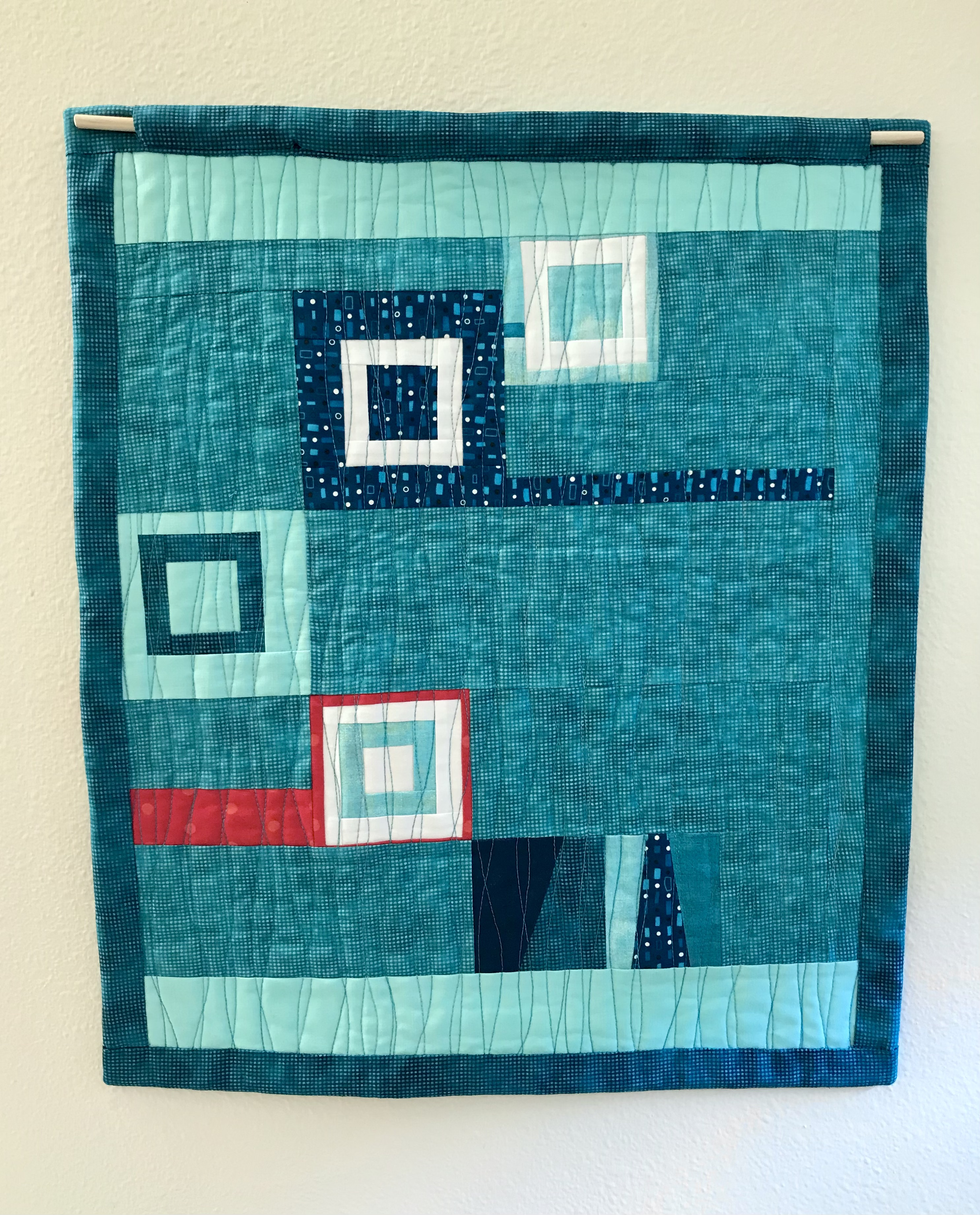 Quilt back turquoise with red accent