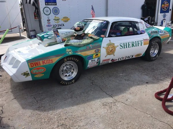 This 1981 Pontiac Firebird Trans Am was a former drug car now running for the law.