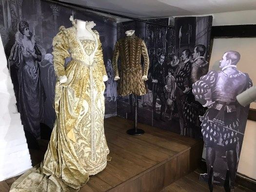 Dame Ellen Terry's costumes displayed in front of the backdrop created by Corvidae Ltd.