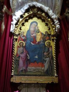 Madonna and Child with Saints.