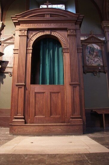 Old wooden confession booth