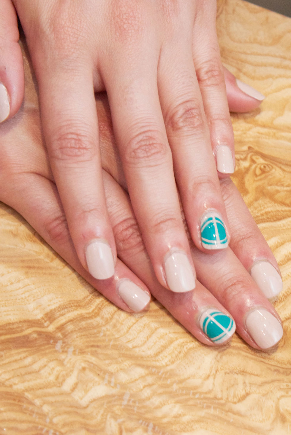 Structure with a touch of whimsy is the vibe for this astrological mashup. Detail-oriented Virgos will identify with clean Virgo-Go Pink polish and a neatly stenciled graphic design. That bright turquoise? Chalk it up to Age of Aquarius's inventive, free-flowing nature.