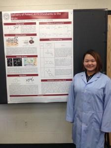 CCB Dialogue student Maochi Li displays her research poster.