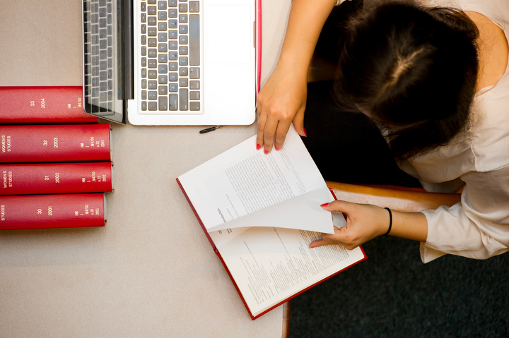 A photo from above of a student studying in Snell Library