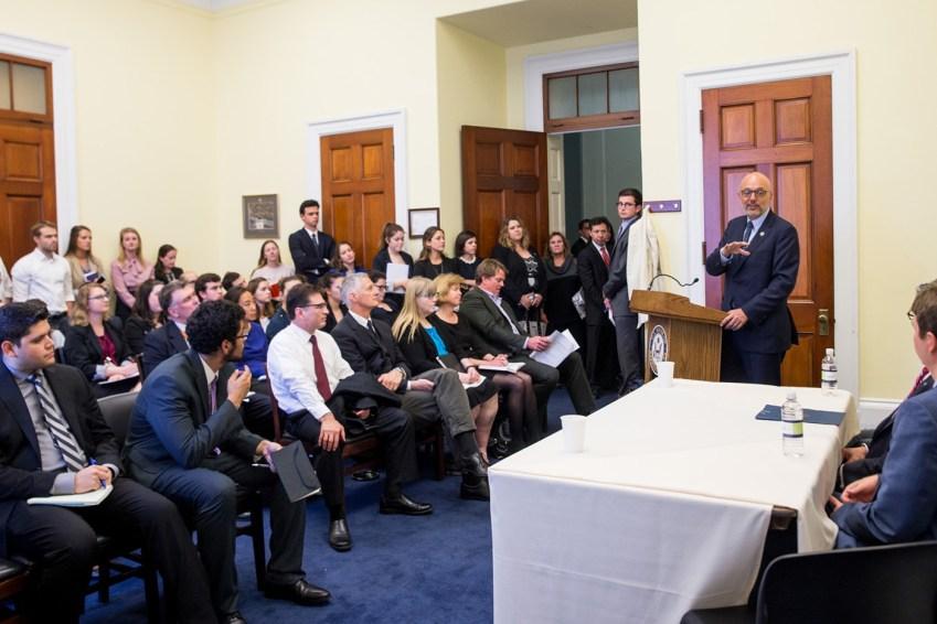 Men in a room talking
